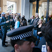 Julian Assange leaving St Paul's Square and Occupy LSX facilitated by police.