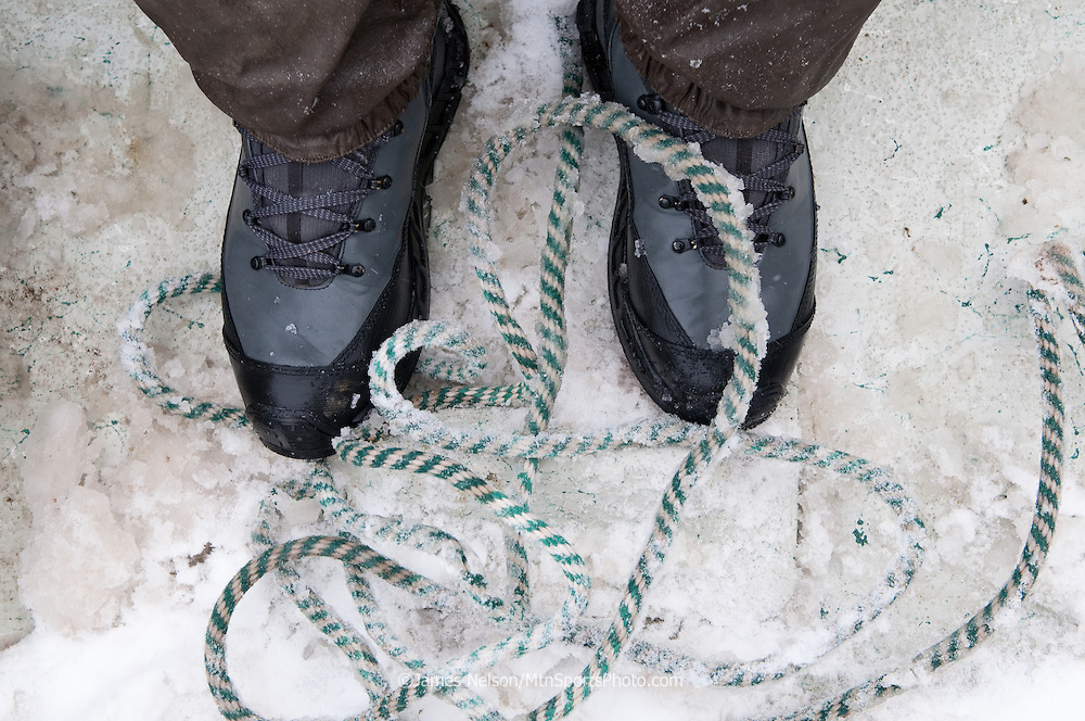 A frozen anchor rope lies at the bottom of a drift boat during a winter fishing trip on the South Fork of the Snake River, Idaho.