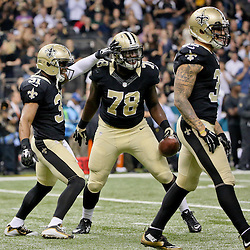 Dec 27, 2015; New Orleans, LA, USA; New Orleans Saints defensive end Bobby Richardson (78) celebrates with free safety Jairus Byrd (31) and strong safety Kenny Vaccaro (32) after an interception against the Jacksonville Jaguars during the second quarter of a game at the Mercedes-Benz Superdome. Mandatory Credit: Derick E. Hingle-USA TODAY Sports