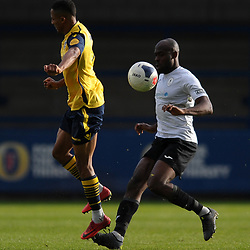 TELFORD COPYRIGHT MIKE SHERIDAN Theo Streete of Telford clears under pressure from Andrai Jones during the Vanarama National League Conference North fixture between AFC Telford United and Guiseley on Saturday, October 19, 2019.<br /> <br /> Picture credit: Mike Sheridan/Ultrapress<br /> <br /> MS201920-026