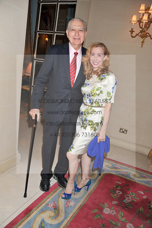 AMBASSADOR JOHN LOEB and SHARON HANDLER at Ambassador Earle Mack's 60's reunion party held at The Ritz Hotel, London on 18th June 2012.