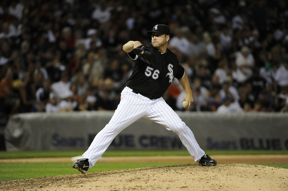 CHICAGO - JULY 09:  Mark Buehrle #56 of the Chicago White Sox pitches against the Kansas City Royals on July 9, 2010 at U.S. Cellular Field in Chicago, Illinois.  The White Sox defeated the Royals 8-2.  (Photo by Ron Vesely)