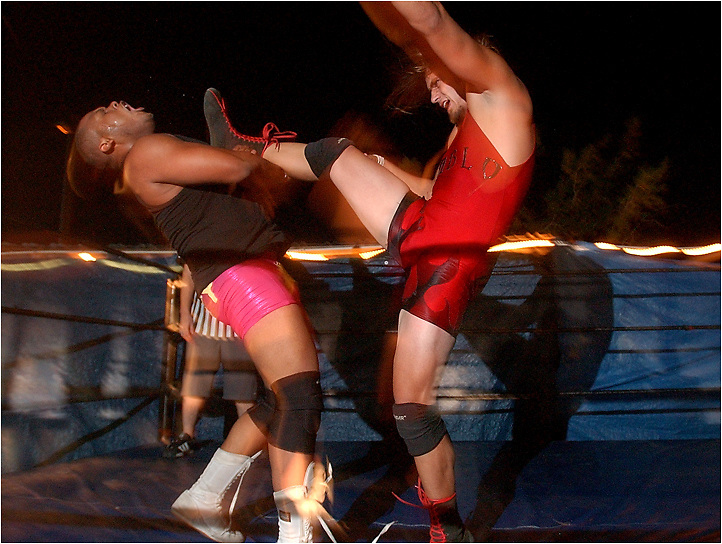 Michael Stenerson / Staff Photographer.Sexy Sonny Samson, left, gets a kick to the neck from El Diablo during their wrestling match Wednesday night at the Hesperia VFW on Hesperia Road. The wrestling event was put on by High Risk Wrestling of the High Desert, which raised about 400 dollars that will go as a donation to the Victorville Red Cross.