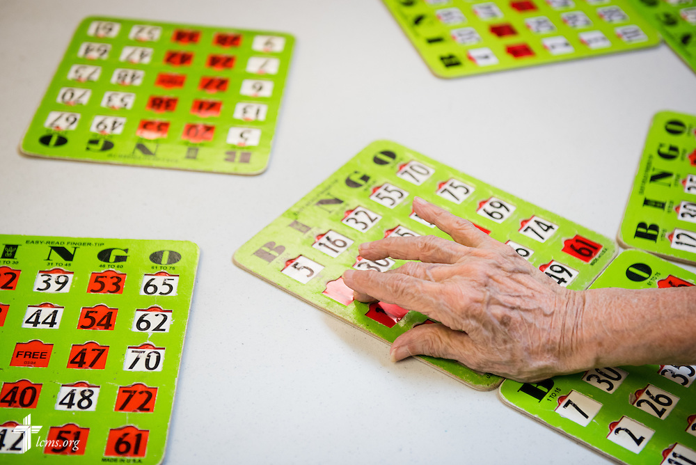 An elderly resident plays bingo with Y4Life student volunteers (not pictured) on Saturday, Sept. 12, 2015, at an elderly living center in Sanford, Fla. The volunteers were part of a Y4Life servant event in the area. LCMS Communications/Erik M. Lunsford