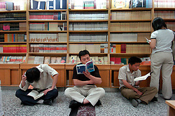 Customers reading books inside large bookshop in Beijing China