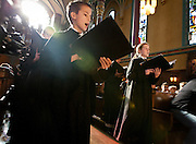 The Choristers of the Madeleine Choir School, conducted by Melanie Malinka, process down the aisle during the Ceremony of Carols at the Cathedral of Madeleine, Friday, Dec. 21, 2012