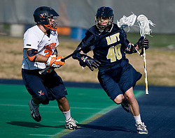 Navy attackman Nick Mirabito (40) takes on Virginia defenseman Ryan Nizolek (24).  The Virginia Cavaliers scrimmaged the Navy Midshipmen in lacrosse at the University Hall Turf Field  in Charlottesville, VA on February 2, 2008.