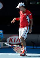Australian Open 2012, Melbourne Park,ITF Grand Slam Tennis Tournament, Kei Nishikori (JPN) wirft seinen Schlaeger weg,Aerger,Frust,Emotion,.Einzelbild,Ganzkoerper,Hochformat,