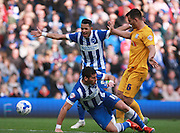 Brighton striker Tomer Hemed takes a tumble after a challenge by Preston North End defender Bailey Wright during the Sky Bet Championship match between Brighton and Hove Albion and Preston North End at the American Express Community Stadium, Brighton and Hove, England on 24 October 2015. Photo by Bennett Dean.