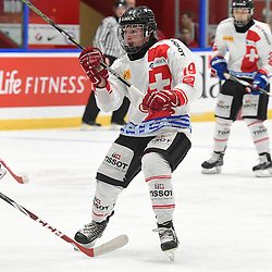WHITBY, - Dec 13, 2015 -  WJAC Game 2- Team Switzerland vs Team Canada East at the 2015 World Junior A Challenge at the Iroquois Park Recreation Complex, ON. Axel Simic #19 of Team Switzerland follows the play during the second period.<br /> (Photo: Andy Corneau / OJHL Images)