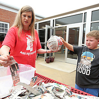 Shannon Carlise, the second grade challenge teacher at Lawhon, works with summer camp student Will Zahn, 7, to complete his paper mache for the rechenka's eggs project at theTupelo Public School District's summer camp at Lawndale Wednesday morning.