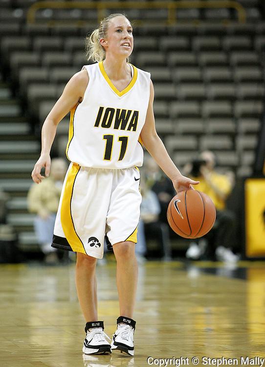 28 NOVEMBER 2007: Iowa guard Kristi Smith (11) in the first half of Georgia Tech's 76-57 win over Iowa in the Big Ten/ACC Challenge at Carver-Hawkeye Arena in Iowa City, Iowa on November 28, 2007.