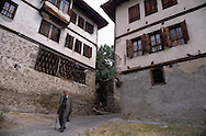 SAFRANBOLU, TURKEY AUGUST 2003. A old man walks between the traditional houses. The city of Safranbolu positioned in the forests on the Black Sea coast is one of the world heritage sites of the UNESCO. Apart from its Ottoman era wood and mudbrick houses it is also known for its 'Lokum' or Turkish delight. A delicate sweets with flavours from nuts to rose petals. Photo by Frits Meyst/Adventure4ever.com
