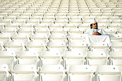 A lone fan sitting in the the Jassim Bin Hamad Stadium, also known as Al Sadd Stadium, home to Al Sadd of the Qatar National First Division