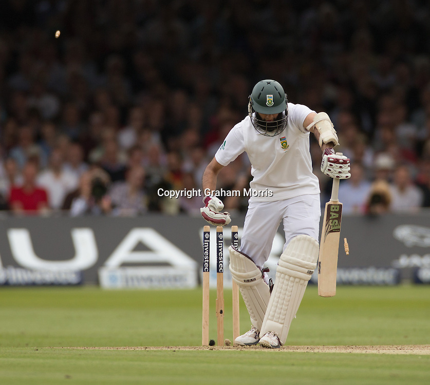 Hashim Amlais bowled by Steven Finn during the third and final Investec Test Match between England and South Africa at Lord's Cricket Ground, London. Photo: Graham Morris (Tel: +44(0)20 8969 4192 Email: sales@cricketpix.com) 16/08/12