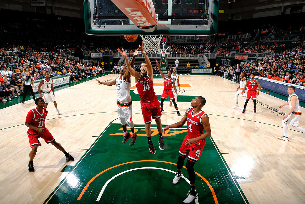 December 31, 2016: Ebuka Izundu #15 of Miami tries to out rebound Omer Yurtseven #14 of North Carolina State during the NCAA basketball game between the Miami Hurricanes and the North Carolina State Wolfpack in Coral Gables, Florida. The 'Canes defeated the Wolfpack 81-63.
