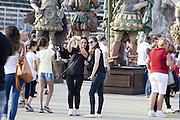 Visitors photographing themselves with a smartphone in front of the statues of the People of the food by the set designer Dante Ferretti in Expo 2015, Rho-Pero, June 2015. &copy; Carlo Cerchioli<br /> <br /> Visitatrici si fotografano con uno smartphone di fronte alle statue del Popolo del cibo opera dello scenografo Dante Ferretti a Expo 2015, Rho-Pero, giugno 2015.