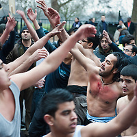 LONDON, ENGLAND - FEBRUARY 07:  A Shiite Muslim devotees beats up their chest during the 29th Arbaeen Procession on February 7, 2010 in London, England. Arbaeen occurs 40 days after the day of Ashura, the commemoration of the martyrdom of Imam Husain in Karbala  (Photo by Marco Secchi/Getty Images)