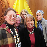Sr. Joan Brown, Sr. Marlene Perrotte, Joyce Overton, Ruth Striegel and <br /> Gov. Michelle Lujan Grisham celebrate after the governor signed a climate change accord.