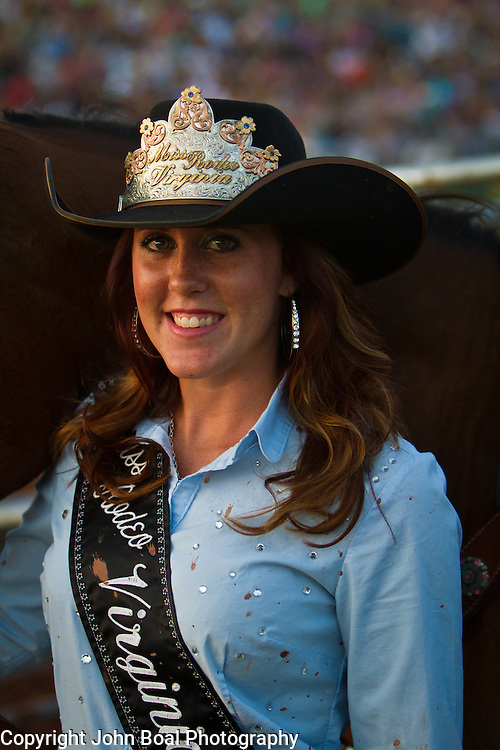 """during the Prince William County Fair, in Manassas, VA, on Sunday, August 10, 2014. John Boal PhotographyMelissa McMullan, Miss Rodeo Virginia 2014, of Ft. Valley, VA, stands with her horse, Sarah, during the Dave Martin Rodeo, at the Prince William County Fair, in Manassas, VA, on Sunday, August 10, 2014.  McMullan represents Virginia regionally and nationally, while promoting """"rodeos and the western lifestyle"""" in Virginia.  John Boal Photography"""