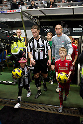 NEWCASTLE, ENGLAND - Saturday, December 11, 2010: Liverpool's goalkeeper Jose Reina and Newcastle United's captain Kevin Nolan walks out before the Premiership match at St James' Park. (Photo by: David Rawcliffe/Propaganda)