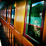 A passenger relaxes on the TSS Earnslaw, the 100 year old vintage coal fired passenger steam ship which sails on Lake Wakatipu, Queenstown, New Zealand. The popular tourist attraction is celebrating it's centenary year with celebrations planned for October 2012.  Queenstown, Central Otago, New Zealand. 29th February 2012. Photo Tim Clayton