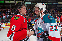 KELOWNA, CANADA - APRIL 14: Cody Glass #8 of the Portland Winterhawks shakes hands with Reid Gardiner #23 of the Kelowna Rockets on April 14, 2017 at Prospera Place in Kelowna, British Columbia, Canada.  (Photo by Marissa Baecker/Shoot the Breeze)  *** Local Caption ***