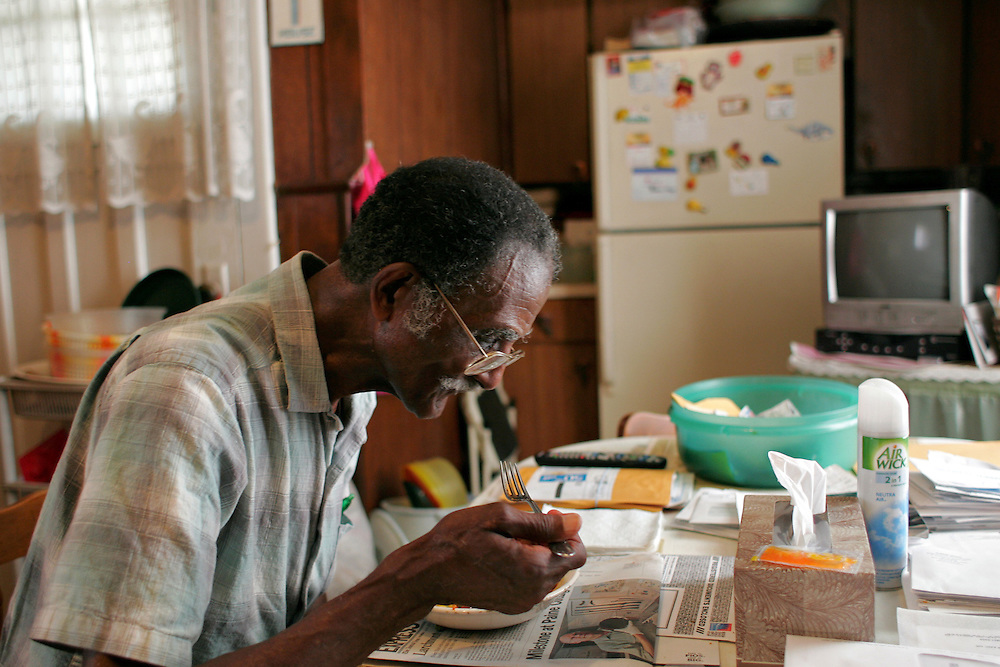 Xavier Mascareñas/The Journal News; Lawrence Cunningham Jr., 51, visits his father, Lawrence Cunningham Sr., 84, on a regular basis to drop off groceries for him at his New Rochelle home. Lawrence Sr. is photographed eating a meal in his kitchen on July 9, 2010. He is eating before going to the hospital to visit his wife, Lawrence Jr.'s mother, who he visits three times a day to help with her meals.