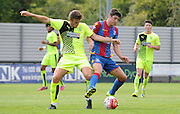 Jake Gray battles for the ball during the U21 Professional Development League match between Crystal Palace U21s and Huddersfield U21s at Imperial Fields, Tooting, United Kingdom on 7 September 2015. Photo by Michael Hulf.