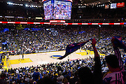 Golden State Warriors fans twirl their Splash Towels during a game against the LA Clippers at Oracle Arena in Oakland, Calif., on February 23, 2017. (Stan Olszewski/Special to S.F. Examiner)