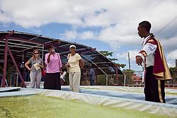 Agriculture and aquaponics student Tequan Maduro walks visitors through the Tilapia Farm.