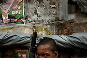 Dhaka, Bangladesh. A young man poses with a gun near the Sadarghat ferry terminal. Part of a story on life in Bangladesh's capital after being voted the worst city in the world to live.