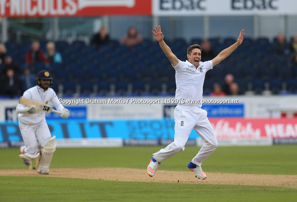 Chris Woakes appeals in vain (after a review) for the lbw of Dinesh Chandimal (left) during the second Investec Test Match between England and Sri Lanka at Chester-le-Street, Durham. Photo: Graham Morris/ Photosport.nz
