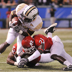 Dec 19, 2009; St. Petersburg, Fla., USA; Rutgers cornerback Devin Mccourty (21) tackles UCF wide receiver Quincy McDuffie (14) during NCAA Football action in Rutgers' 45-24 victory over Central Florida in the St. Petersburg Bowl at Tropicana Field.