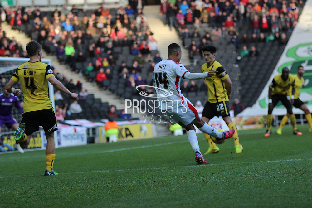 Dele Alli of MK Dons shoots at goal during the Sky Bet League 1 match between Milton Keynes Dons and Barnsley at stadium:mk, Milton Keynes, England on 24 January 2015. Photo by Josh Smith.