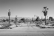 Lot off of Benson Highway with palm trees abandoned area in the desert