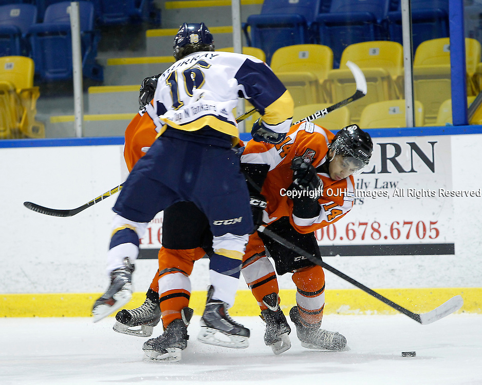 Whitby, ON - Feb 11 : Ontario Junior Hockey League game action between the Whitby Fury and the Orangeville Flyers. Whitby Fury Jeff Murray #16 takes the hit from Orangeville Flyers players during first period game action.<br /> (Photo by Tim Bates / OJHL Images)