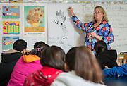 Rebecca Stewart works with her art students at Benavidas Elementary School, April 15, 2014.