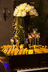 place settings on a piano at a wedding