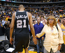 May 15, 2004; Los Angeles, CA, USA; Spurs' Tim Duncan glad hands Penny Marshall as he walks off the court after loosing to the Lakers during game 6 of the Western Conference semifinals at the Staples Center. The Lakers beat the Spurs 88-76.  (Credit Image: © Edward A. Ornelas/San Antonio Express-News/ZUMAPRESS.com)