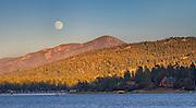 USA, California, Big Bear. Moonrise and sunset over Big Bear Lake in Southern California.