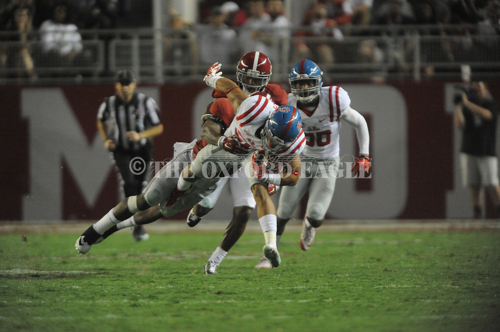 Ole Miss Rebels running back Jordan Wilkins (22) is tackled by Alabama Crimson Tide linebacker Reuben Foster (10) and Alabama Crimson Tide defensive back Cyrus Jones (5) at Bryant-Denny Stadium in Tuscaloosa, Ala. on Saturday, September 19, 2015. Ole Miss won 42-36.