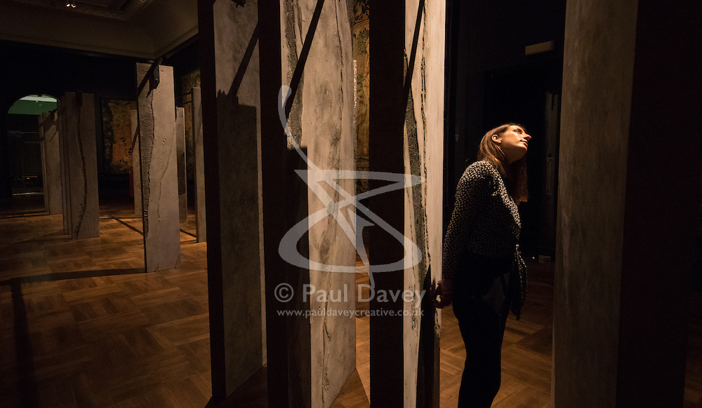 London, September 18th 2015. A woman examines The Ogham Wall by Grafton Architects. Resembling Irish and British standing stones, these 23 'fins' carry an ancient alphabet which originated deep in Irish Celtic history. The Victoria and Albert museum celebrates the London Design Festival runs from 19 – 27 September, displaying a collection of conceptual installation artworks.