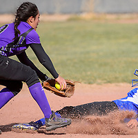 032914       Cable Hoover<br /> <br /> Miyamura Patriot Arianna Meese (9) reaches to tag Zuni Thunderbird Darnell Neha (1) as she slides into second base Saturday at Tohatchi High School.