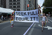 "A banner reading ""Seek full equality"" is borne by Marriage Equality USA."