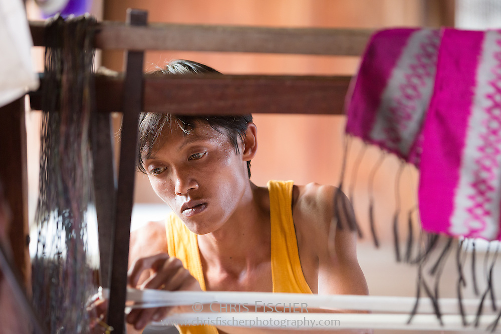 A young man working at a lotus silk workshop of Inn Paw Khon, a village on Inle Lake, Myanmar.