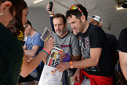 Riders collecting their race packs during the pre race events held at the V&A Waterfront in Cape Town prior to the start of the 2017 Absa Cape Epic Mountain Bike stage race held in the Western Cape, South Africa between the 19th March and the 26th March 2017<br /> <br /> Photo by Emma Hill/Cape Epic/SPORTZPICS<br /> <br /> PLEASE ENSURE THE APPROPRIATE CREDIT IS GIVEN TO THE PHOTOGRAPHER AND SPORTZPICS ALONG WITH THE ABSA CAPE EPIC<br /> <br /> ace2016