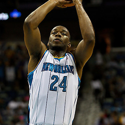 March 30, 2011; New Orleans, LA, USA; New Orleans Hornets power forward Carl Landry (24) against the Portland Trail Blazers during the first half at the New Orleans Arena.    Mandatory Credit: Derick E. Hingle