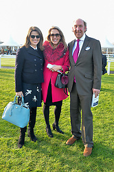 Left to right, CHICA HERBERT and VISCOUNT & VISCOUNTESS DAVENTRY at the 2014 Hennessy Gold Cup at Newbury Racecourse, Newbury, Berkshire on 29th November 2014.  The Gold Cup was won by Many Clouds ridden by Leighton Aspell.