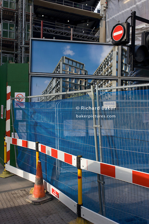 A street corner where temporary construction fencing and disruption has blocked off a City of London street.